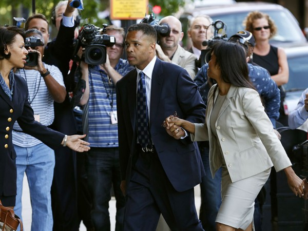 Jackson Jr. and his wife arrive in court for their sentencing hearing in Washington