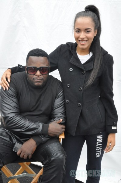 Middleman Fresh (stylist) posing with one of the models.
