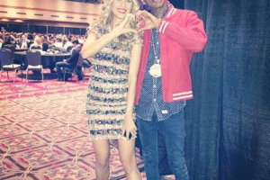 Petra Nemcova and Wiz Khalifa showing their Happy Hearts support.