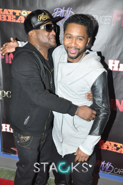 Shawty Lo  on the red carpet congratulating Zaytoven.