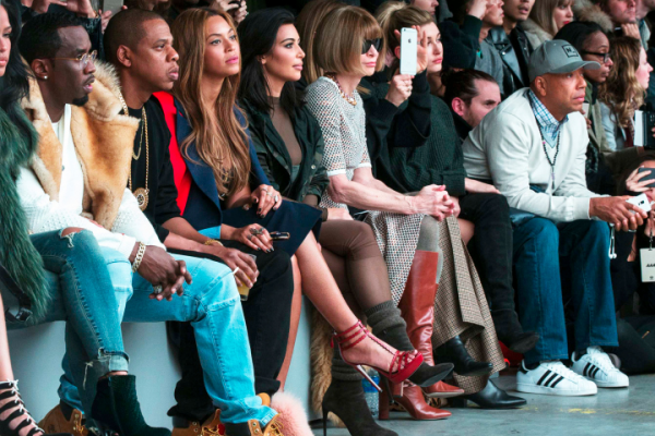 Sean Combs (from left), Jay-Z, Beyonce and Kim Kardashian sit with Vogue Editor Anna Wintour, Hailey Baldwin and Russell Simmons during a presentation of Kanye West's Fall/Winter 2015 partnership with Adidas at New York Fashion Week. [Photo: Lucas Jackson/Reuters]