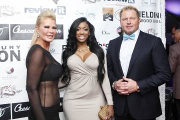 Theresa Roemer, Porsha Williams, and Roger Clemens pose on the red carpet at Theresa Roemer's Fashion Woodlands event.