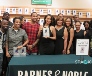 La La poses with her family and friends at book signing.