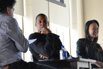 Jay Z  and Vania Schlogel speaking at the Clive Davis Institute at NYU.  (Photo credit: AintNoJigga/Tumblr)