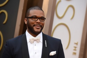 Tyler Perry arrives at the Oscars on Sunday, March 2, 2014, at the Dolby Theatre in Los Angeles.  (Photo by Jordan Strauss/Invision/AP)